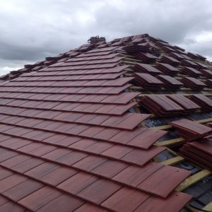 A roof with red slate tiles